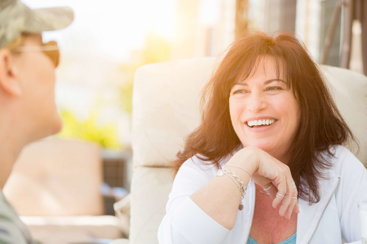 Mature confident woman smiling in conversation